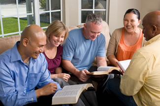 smiling small group learning from the Bible