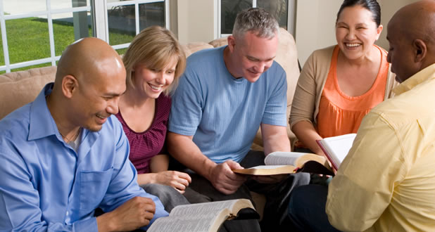 small group spending time together reading their Bibles
